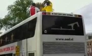 Ajax keeper Maarten Stekelenburg drops trophy from bus