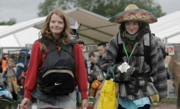Glastonbury Festival 2011 revellers arrive – and so does the mud and rain