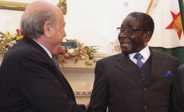 Robert Mugabe and Sepp Blatter handshake sparks Twitter scorn