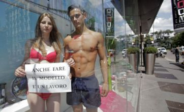 Half-naked real-life window models in bikinis and shorts cause a stir in Milan
