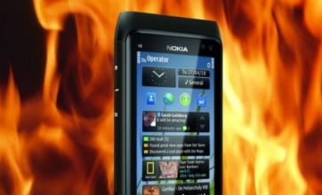 Apple takes smartphone crown as Nokia loses over £400million