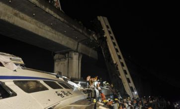 11 dead as train derails and plunges from bridge in China