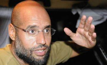 Gaddafi son Saif al-Islam rallies regime forces with bizarre appearance