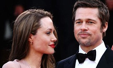 Angelina Jolie dismisses talk of marriage and more babies with Brad Pitt