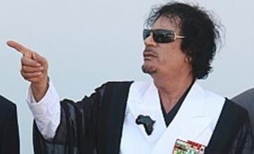 Interpol steps up hunt for Colonel Gaddafi