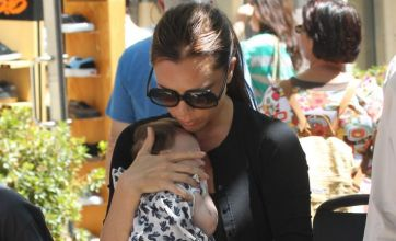 Victoria Beckham goes back to flats on shopping trip with baby Harper