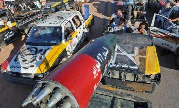 Libyan rebel fighters battle Gaddafi supporters in Bani Walid