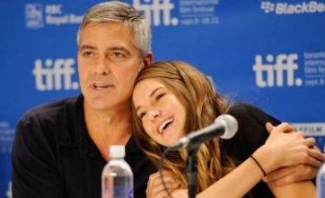 George Clooney cuddles up to co-star Shailene Woodley