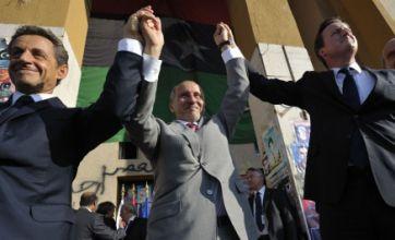 David Cameron and Nicolas Sarkozy given heroes' welcomes in Libya
