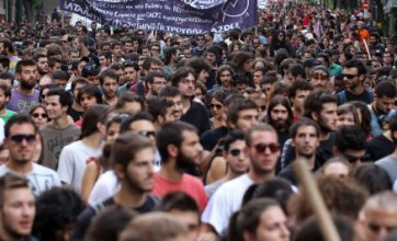New Greek pension cuts prompt workers to strike in Athens