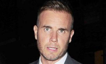 Robbie Williams splitting from Take That 'untrue' – they're on a break