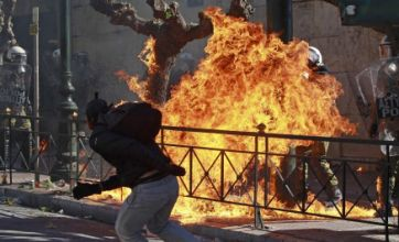 Strike in Greece turns Athens into a battlefield as police and rioters collide