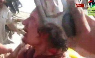 Bloody end for Gaddafi as body shown to the world