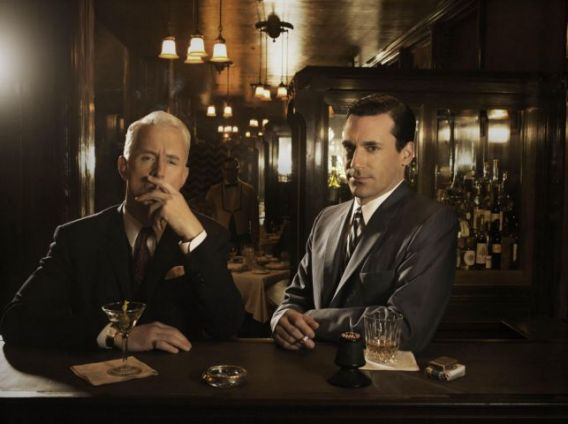 Roger Sterling (John Slattery) and Don Draper (Jon Hamm) enjoy a glass of scotch.