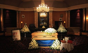 Sir Jimmy Savile's quirky funeral to see him buried sitting up in tracksuit