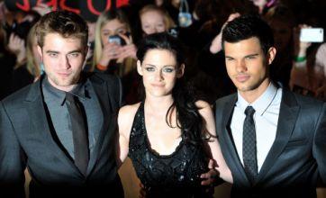 Kristen Stewart hits Twilight: Breaking Dawn premiere in dress and trainers