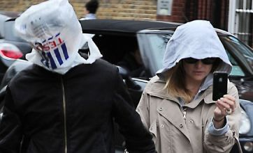 Matt Bellamy fools paps with plastic bag during stroll with Kate Hudson