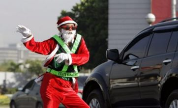Santa traffic warden gets into the Christmas spirit on busy road