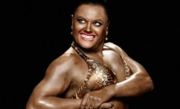 Alan Carr strikes Jodie Marsh bodybuiling pose