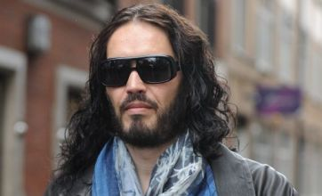 Russell Brand puts on a brave face as he steps out after Katy Perry split