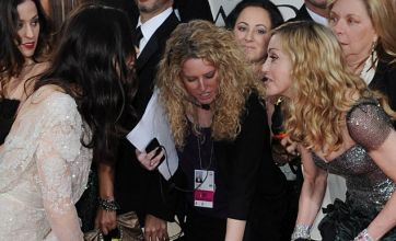 Golden Globes: Awkward moment as Madonna steps on Jessica Biel's dress