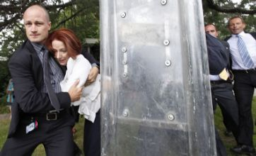Julia Gillard rescued by riot police in Australia Day protests