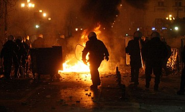 Greek MPs approve austerity bill as protesters clash with riot police