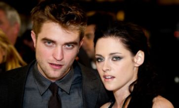 Robert Pattinson and Kristen Stewart look glum as they arrive at LAX