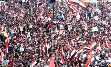 Syrians 'forced' to celebrate first anniversary of uprising