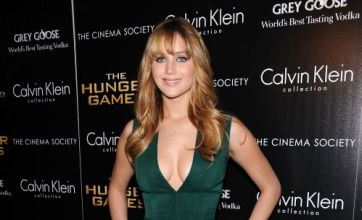Jennifer Lawrence dazzles in plunging dress at The Hunger Games screening