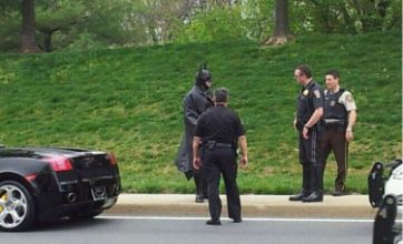 Batman pulled over by traffic officers for having wrong plates on Batmobile