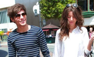 One Direction US fans' hearts break as Louis is joined by girlfriend in LA