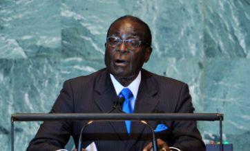 Robert Mugabe 'dying' claims dismissed by Zimbabwe officials