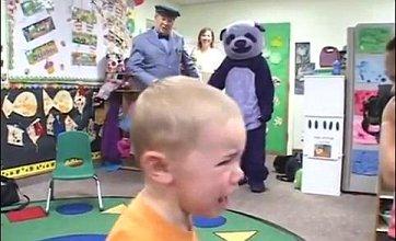 Classroom visit by man in purple panda suit leaves children in tears