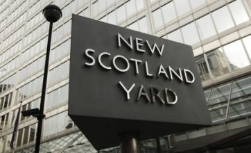 Scotland Yard police officer facing racism charge over London riots
