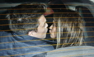 Loved-up Katie Price and Leandro Penna enjoy backseat smooch
