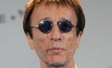 Robin Gibb shows further signs of recovery by 'nodding' to music