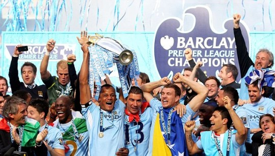 Vincent Kompany the captain of Manchester City lifts the trophy