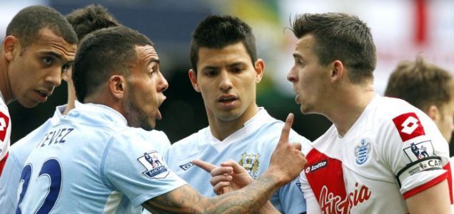 QPR's Joey Barton argues with Manchester City's Carlo Tevez