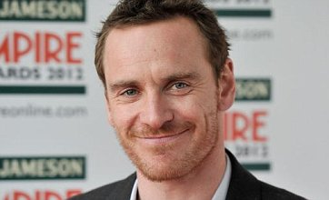 Michael Fassbender gets lucky with a mystery blonde as they disappear into the night