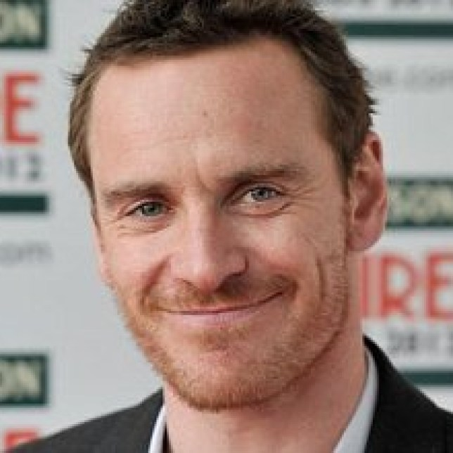 Michael Fassbenderpulls a mystery blonde outside Groucho Club (Picture: Getty)