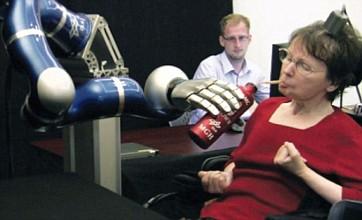 Paralysed woman powers bionic arm with her mind