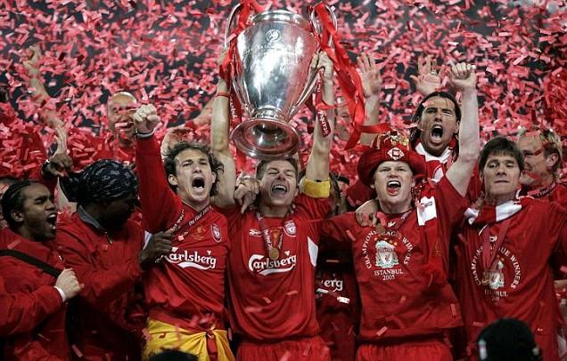 Steven Gerrard, Liverpool captain, holds the trophy aloft.