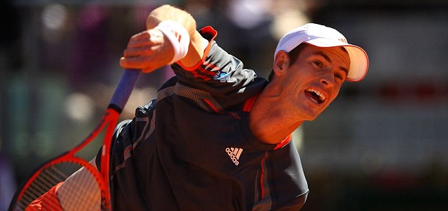 Andy Murray of Great Britain serves against Richard Gasquet