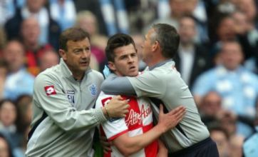 Joey Barton handed 12-match ban after seeing red at Man City