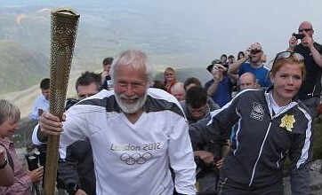 Olympic torch taken to top of Mount Snowdon as relay continues in Wales