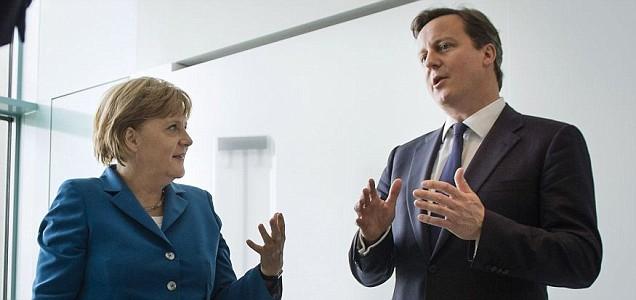 German Chancellor Angela Merkel talks as she receives British Prime Minister David Cameron