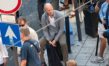 Bruce Willis relaxes on set as new Die Hard movie films in Hungary