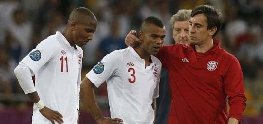 England's assistant coach Gary Neville (R) comforts England's Ashley Cole (2nd L) and Ashley Young