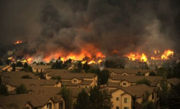 Suburban inferno rages as wildfires surround Colorado Springs